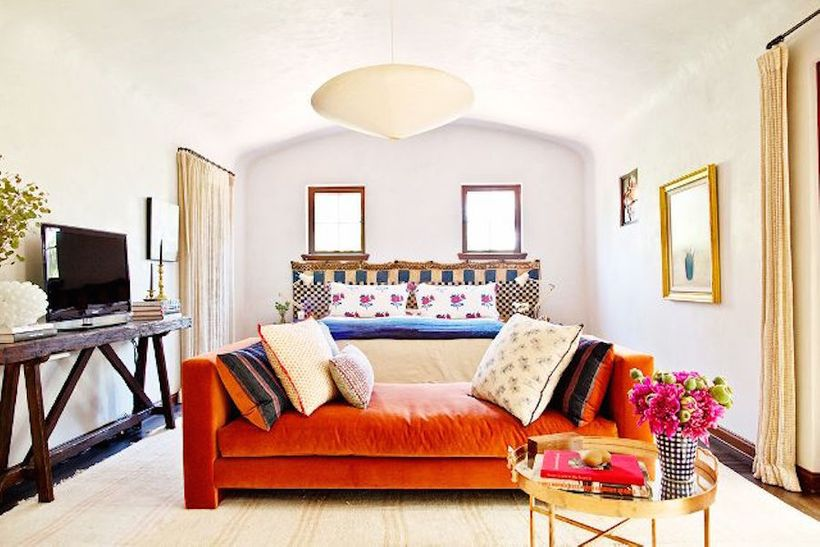 Above A Living Room By Frances Merrill Of Reath Design Draws On The Orange To Draw Eye Fantastic Sofa As Seen In Mydomaine