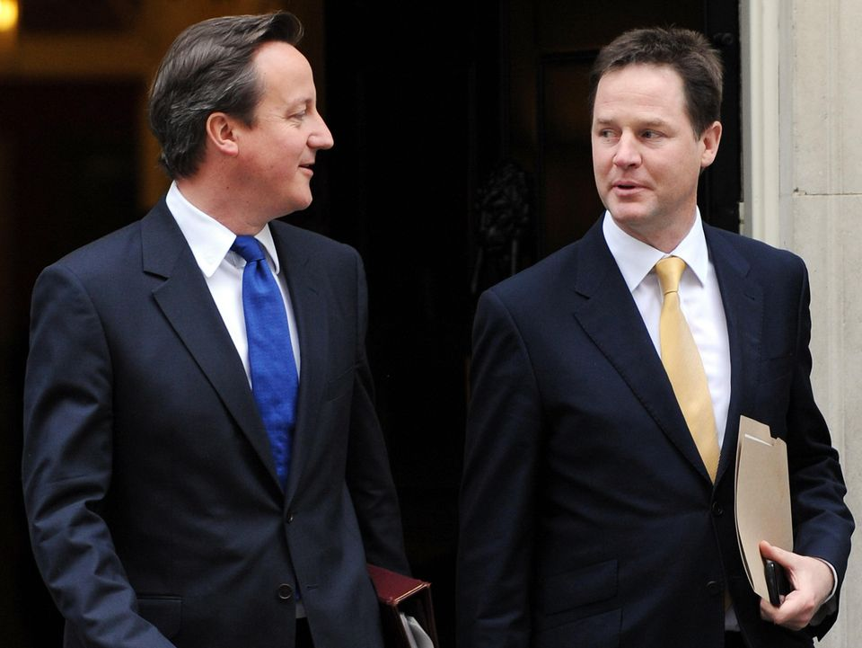 David Cameron and Nick Clegg leave 10 Downing Street during their time in