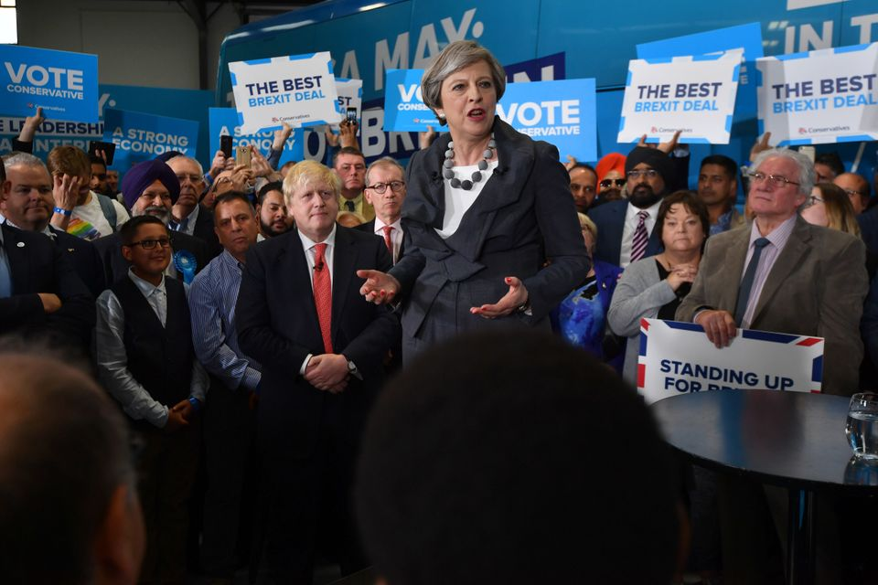 Theresa May is accompanied by Boris Johnson as she addresses supporters at a campaign event on June 6,...