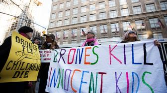 "Members of the group ""Grandmothers Against the War"" hold signs as they protest the use of drone strikes by the U.S. government in New York, U.S. on April 3, 2013.  REUTERS/Lucas Jackson/File Photo"