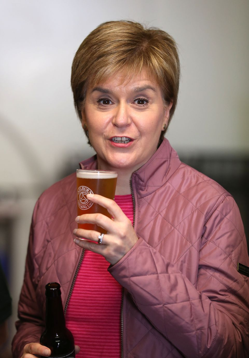 Scotland First Minister Nicola Sturgeon holds a pint of beer during a visit to Kelburn Brewery, in Barrhead,...