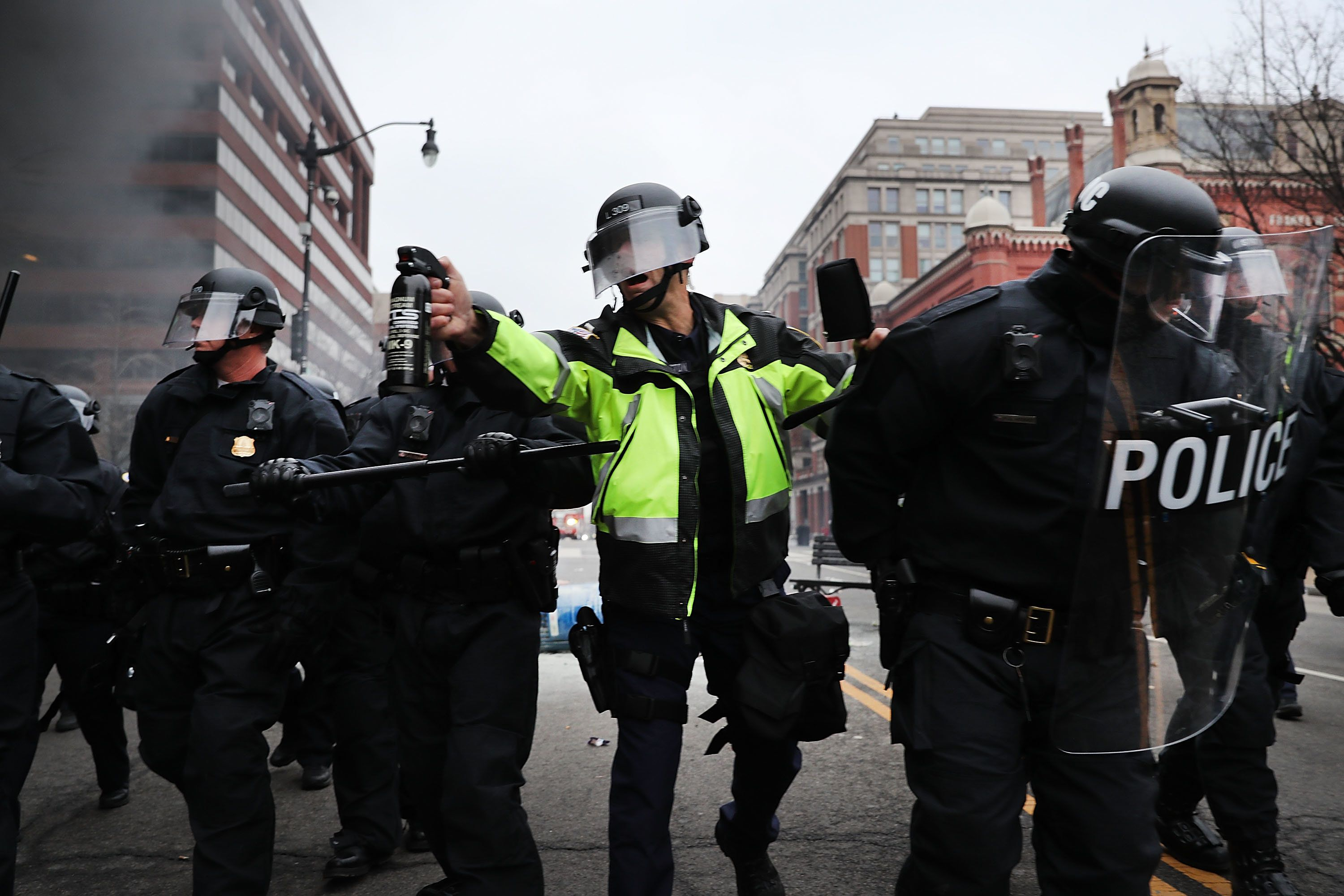 WASHINGTON, DC - JANUARY 20:  A police officer holds a tear gas cannister as police and demonstrators clash in downtown Washington after a limo was set on fire following the inauguration of President Donald Trump on January 20, 2017 in Washington, DC. Washington and the entire world have watched the transfer of the United States presidency from Barack Obama to Donald Trump, the 45th president.  (Photo by Spencer Platt/Getty Images)