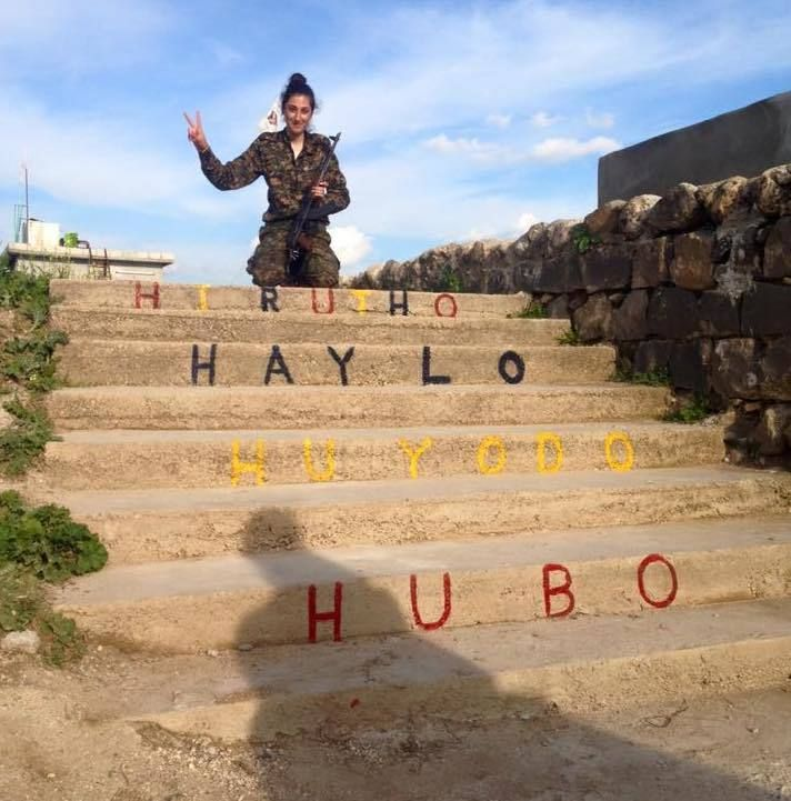 On her way to Raqqa she wrote Hirutho, Haylo, Huyodo, Hubo which  means Freedom, Strength, Unity and Love