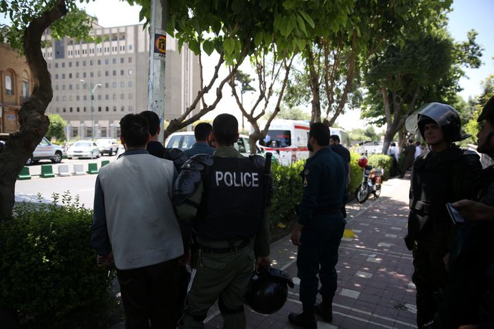 A guard was killed on Wednesday when armed men launched an attack on the parliament in central Tehran.