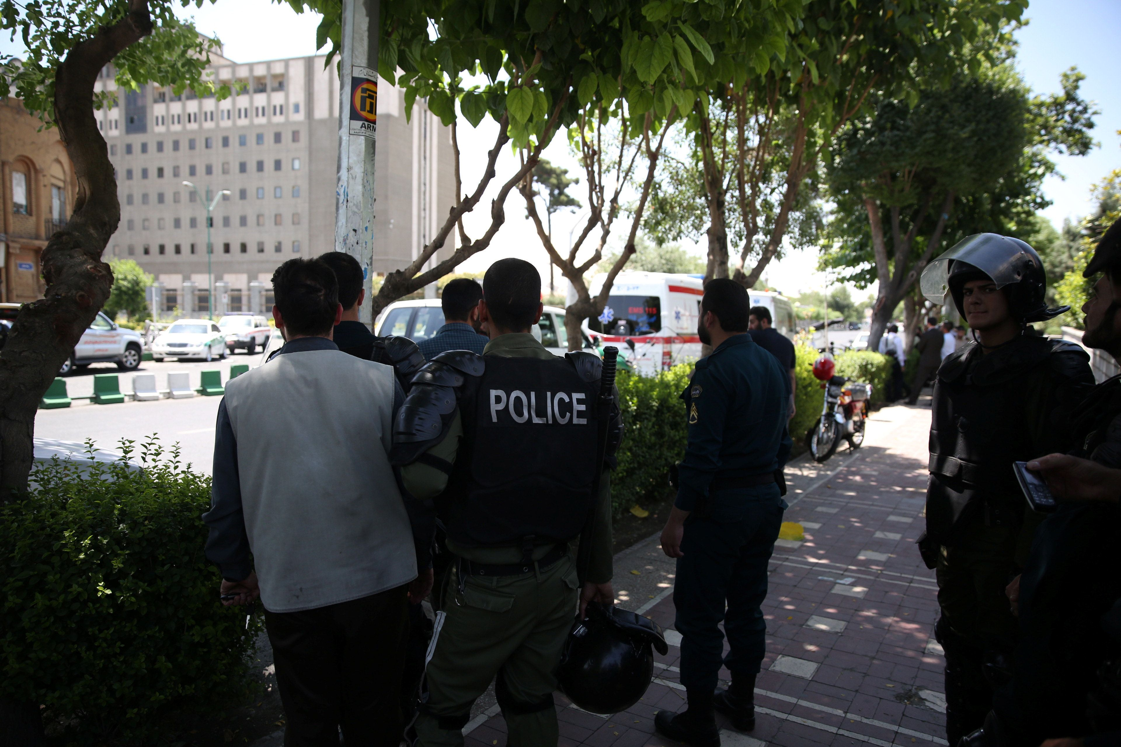 A guard was killed on Wednesday when armed men launched an attack onthe parliament in central Tehran.