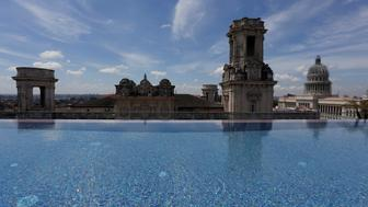 A historic building is seen from the rooftop infinity pool at the Gran Hotel Manzana, owned by the Cuban government and managed by Swiss-based Kempinski Hotels SA, in Havana, Cuba May 12, 2017. Picture taken May 12, 2017. REUTERS/Stringer