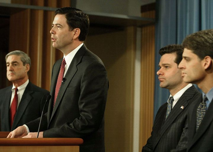 In this 2004 file photo,then-FBI DirectorRobert Mueller, then-Deputy Attorney General James B. Comey and then-Ass