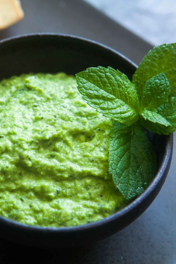 "<strong>Get the <a href=""http://www.simplyrecipes.com/recipes/spring_pea_hummus/"" target=""_blank"">Fresh Pea Hummus recipe</a>"