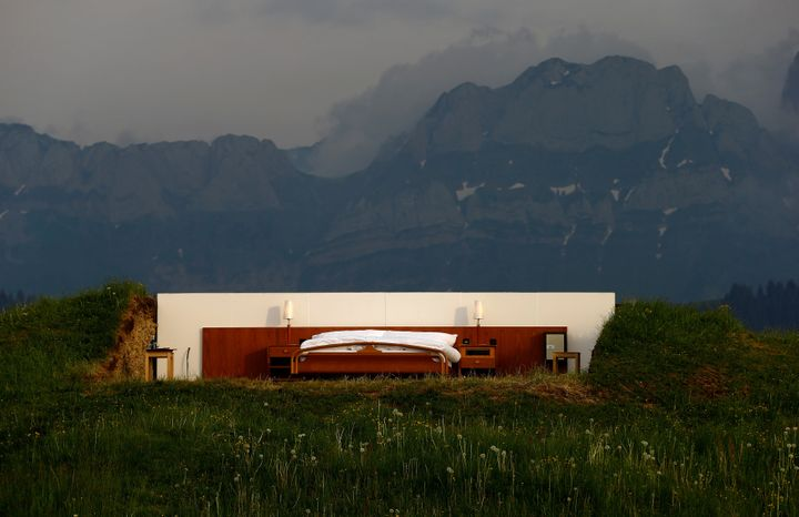 The bedroom sits on an alp near Gonten, Switzerland.
