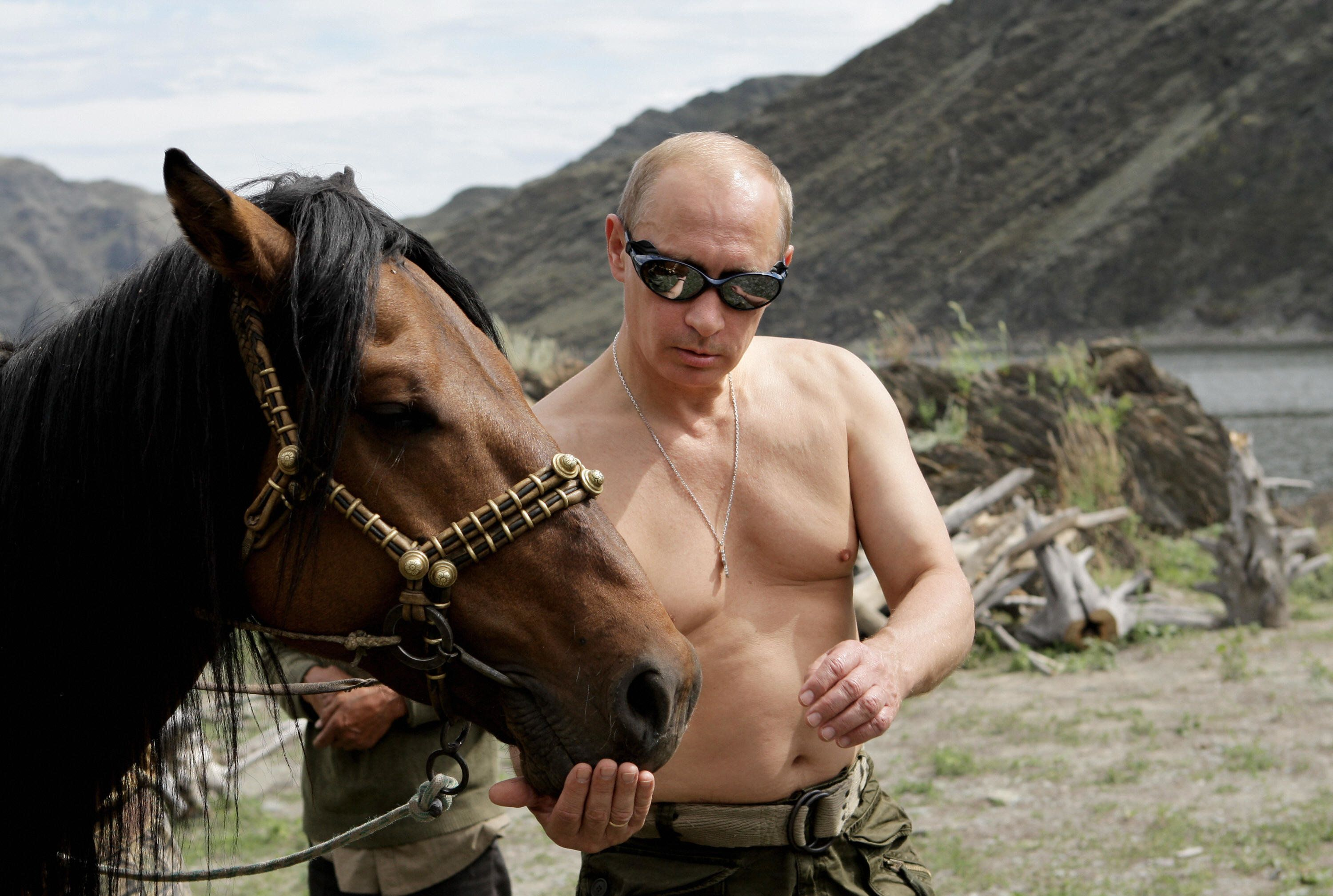 Russian Prime Minister Vladimir Putin is pictured with a horse during his vacation outside the town of Kyzyl in Southern Siberia on August 3, 2009.  AFP PHOTO / RIA-NOVOSTI / ALEXEY DRUZHININ (Photo credit should read ALEXEY DRUZHININ/AFP/Getty Images)