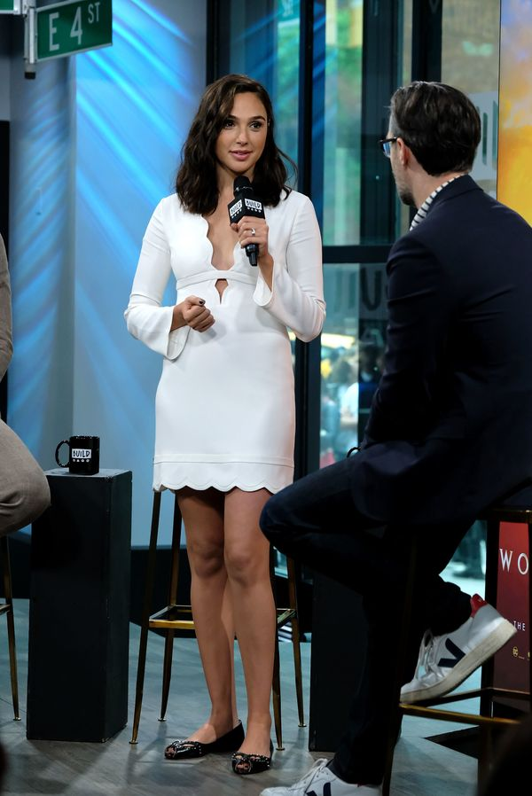 Wearing studded Christian Louboutin flats at AOL Build in New York City.