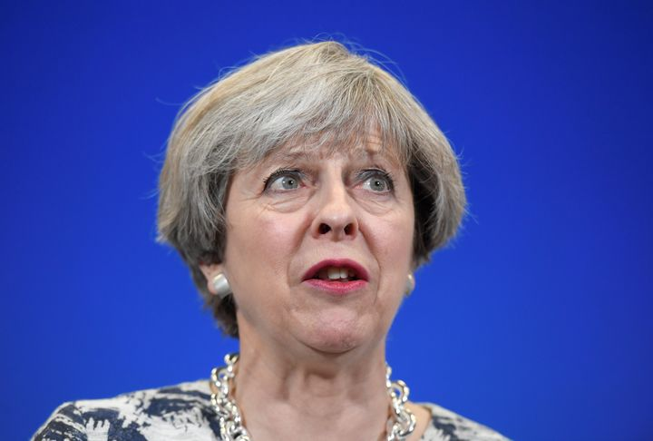 British Prime Minister Theresa May's snap vote gamble backfired, leaving her weakened government scrambling to join forces wi