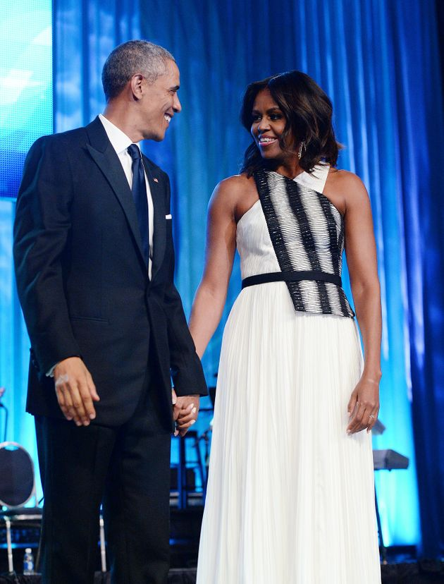 U.S. President Barack Obama and First Lady Michelle Obama arrive on stage for the Congressional Black...