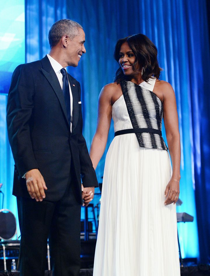 U.S. President Barack Obama and First Lady Michelle Obama arrive on stage for the Congressional Black Caucus Foundation Annual Phoenix Awards dinner, September 27 2014 in Washington, DC.