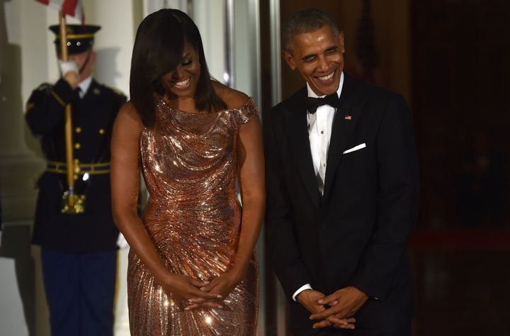 US President Barack Obama and First Lady Michelle Obama wait for the arrival of Italian Prime Minister Matteo Renzi and his wife Agnese Landini on the North Portico of the White House before a state dinner in Washington, DC on October 18 2016.