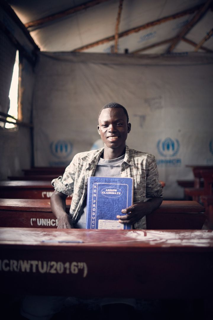 <p>David with his exercise book which he brought from South Sudan</p>