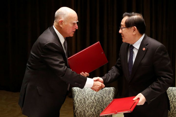 California Gov. Jerry Brown and Chinese Minister of Science and Technology Wan Gang attend a signing ceremony at the International Forum on Electric Vehicle Pilot Cities and Industrial Development in Beijing, China on June 6, 2017.