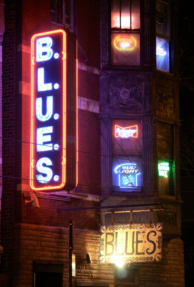 The façade and neon signs at B.L.U.E.S.