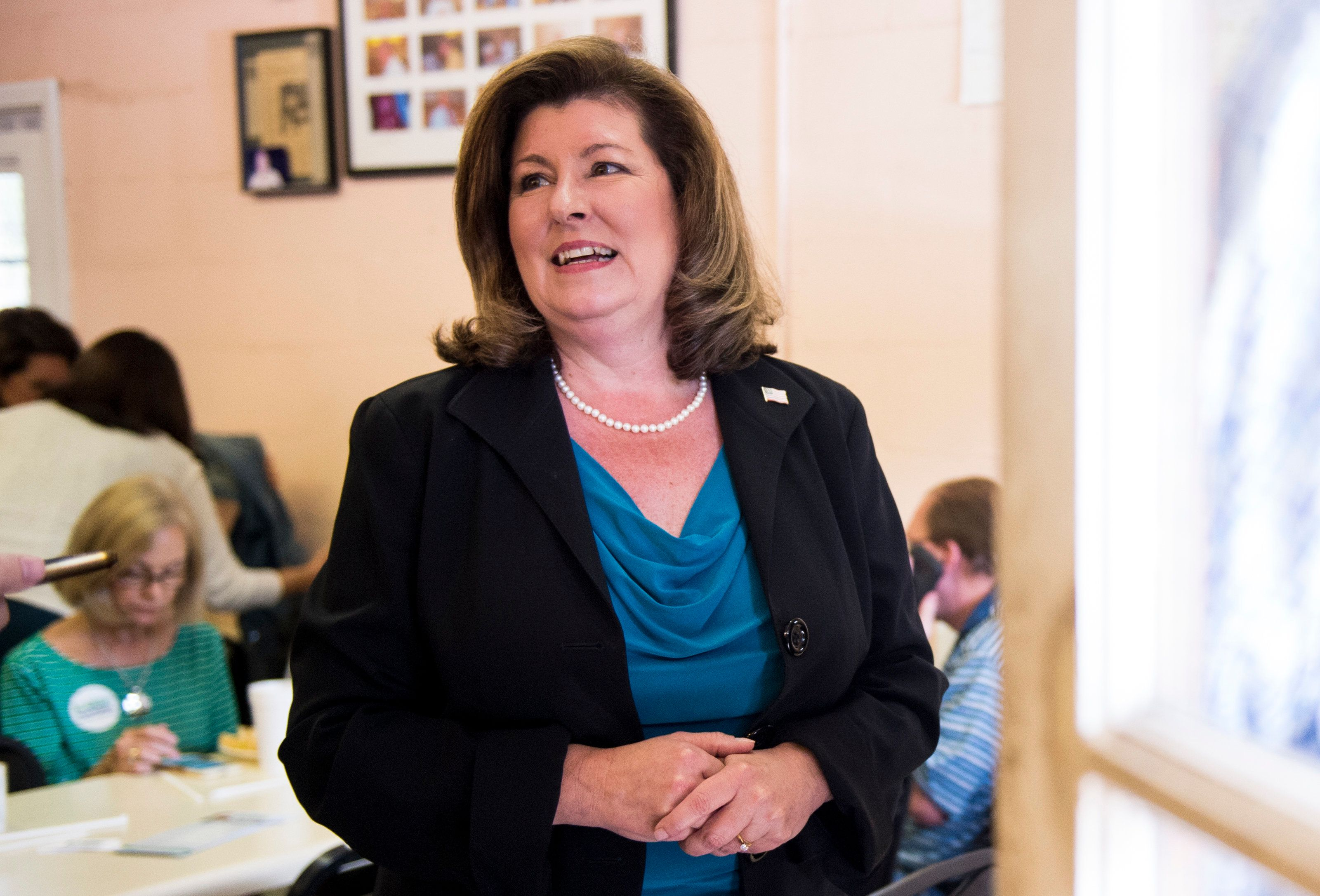 Republican Karen Handel, seen here campaigningin Roswell, Georgia, in April, said on Tuesday night that she does not su