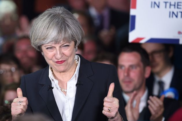 Theresa May gives the thumbs up after praise from