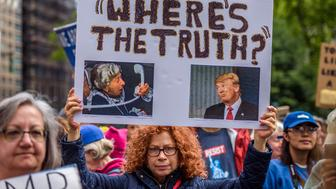 FOLEY SQUARE, NEW YORK, UNITED STATES - 2017/06/03: Hundreds of people marched on June 3, 2017; through lower Manhattan to demand an impartial investigation into alleged Russian interference in the presidential election. The 'March for Truth' was one of many demonstrations held nationwide calling for an investigation into ties between Russia and Donald Trump and his associates. (Photo by Erik McGregor/Pacific Press/LightRocket via Getty Images)
