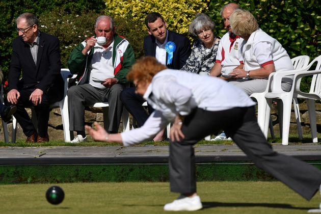 Theresa May watching bowls in