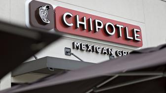 Chipotle Mexican Grill Inc. signage is displayed outside a restaurant in Peoria, Illinois, U.S., on Friday, April 22, 2016. Chipotle Mexican Grill Inc. is expected to release earnings figures on April 26. Photographer: Daniel Acker/Bloomberg via Getty Images