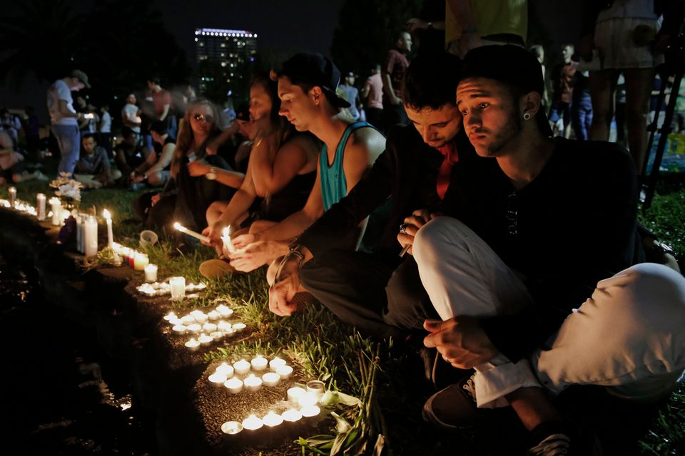 ORLANDO, FL - JUNE 12: Johnpaul Vazquez, right, and his boyfriend Yazan Sale, sit by Lake Eola, in downtown