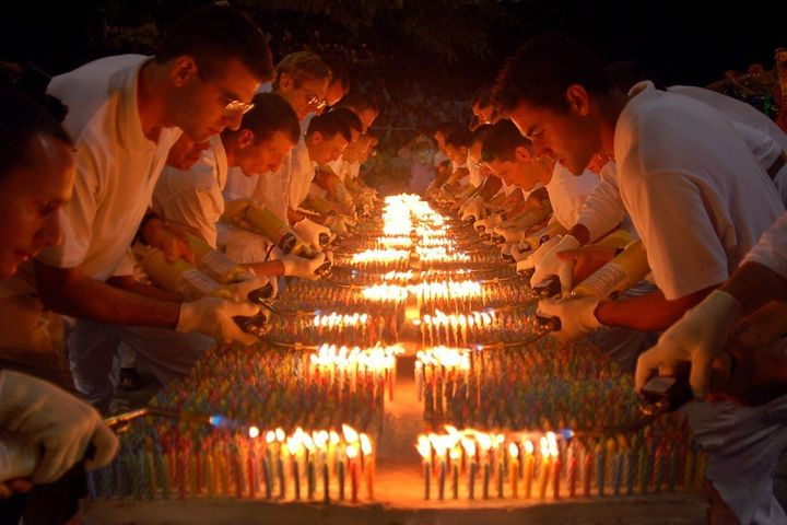 27,000 birthday candles are lit to set a new Guinness record in New York, in 2005.