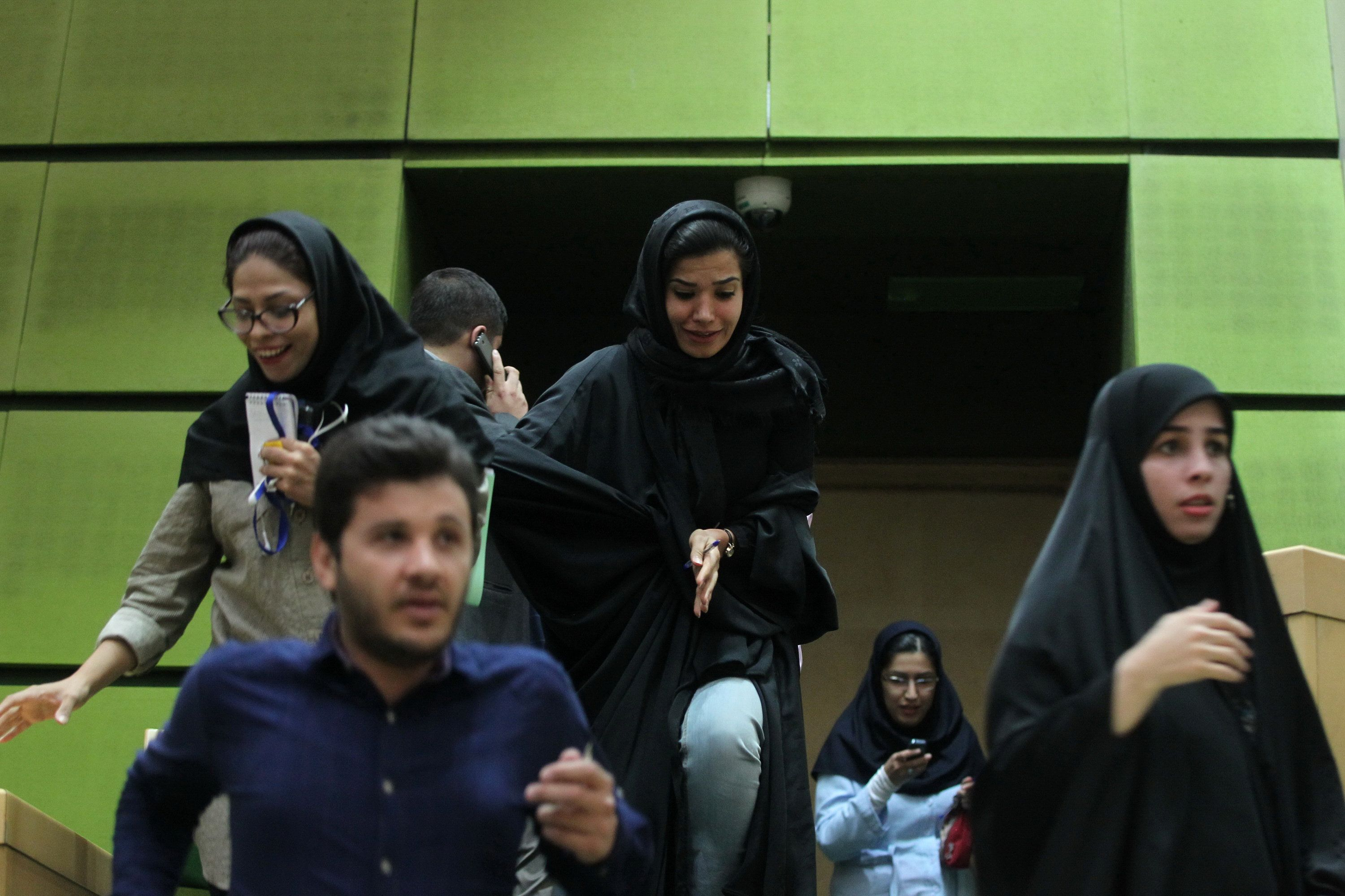 Women are seen inside the parliament during an attack in central Tehran, Iran, June 7, 2017. TIMA via REUTERS ATTENTION EDITORS - THIS IMAGE WAS PROVIDED BY A THIRD PARTY. FOR EDITORIAL USE ONLY.