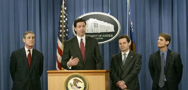 Wray, third from left, listens as James Comey speaks at a 2004 press conference. Robert Mueller (far left), then head of the