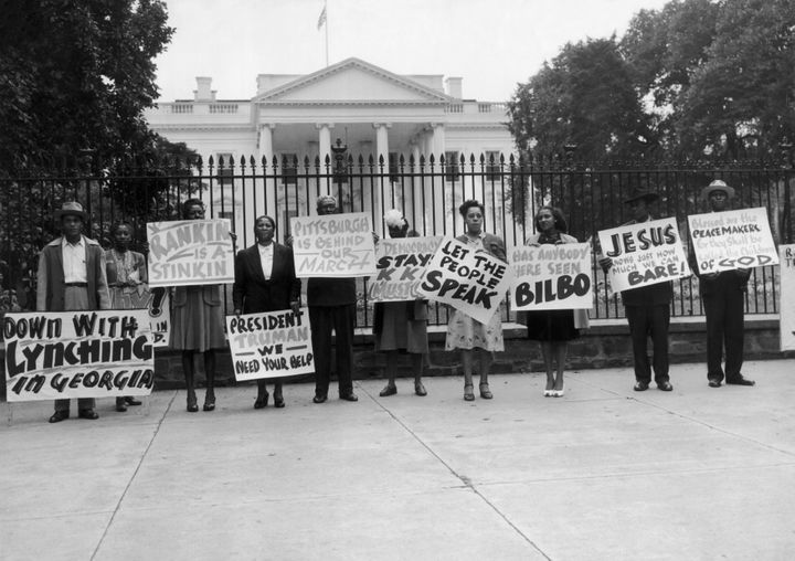 People demonstrate outside the White House against the lynching of black people in 1946.