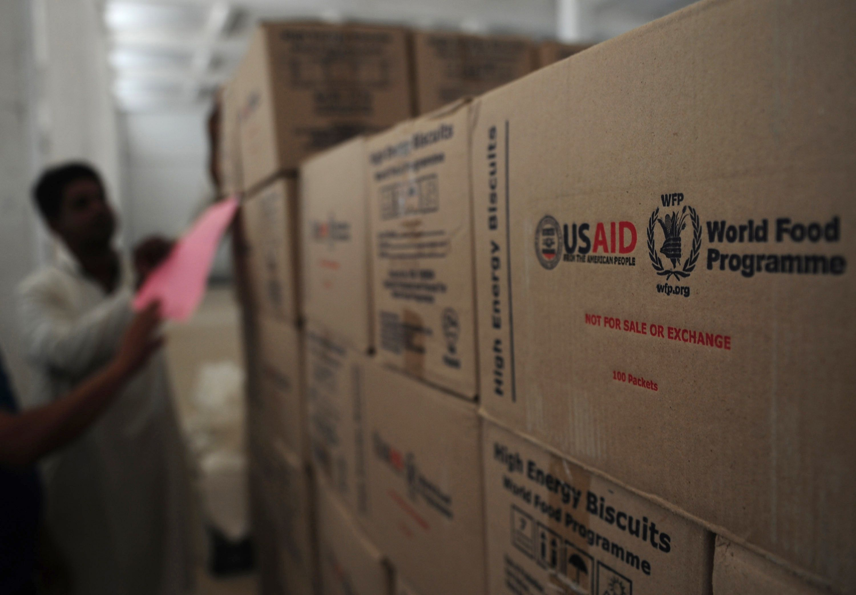 A Pakistani worker arranges aid supplies at a supply centre in the Jacobabad district in 2012. The president's spending