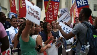 WASHINGTON, DC - JUNE 25: Young college students celebrate in front of the US Supreme Court after a ruling was announced in favor of the Affordable Care Act. June 25, 2015 in Washington, DC. The high court ruled that the Affordable Care Act may provide nationwide tax subsidies to help poor and middle-class people buy health insurance. (Photo by Mark Wilson/Getty Images)