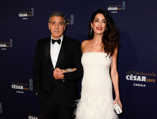 George and Amal Clooney given diapers, tequila to welcome twins