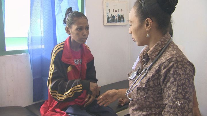Diagnosed with leprosy, this young woman cannot hide her shock.  Later she is told by the doctor that it is curable.  (Papua