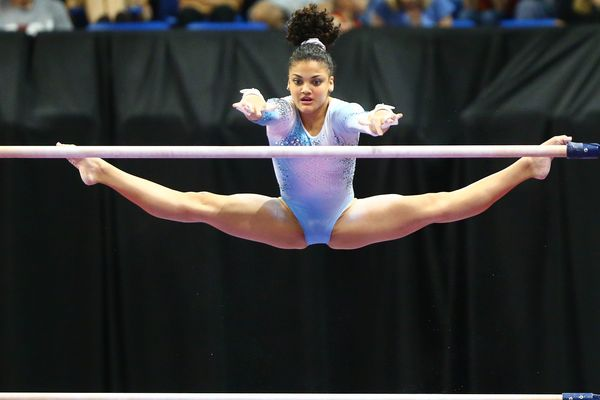 Laurie Hernandez competes on the uneven bars during Day 2 of the 2016 P&G Gymnastics Championships at Chafitz Arena