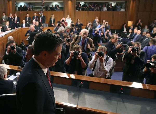 The cameras are snapping as Comey arrives to testify.