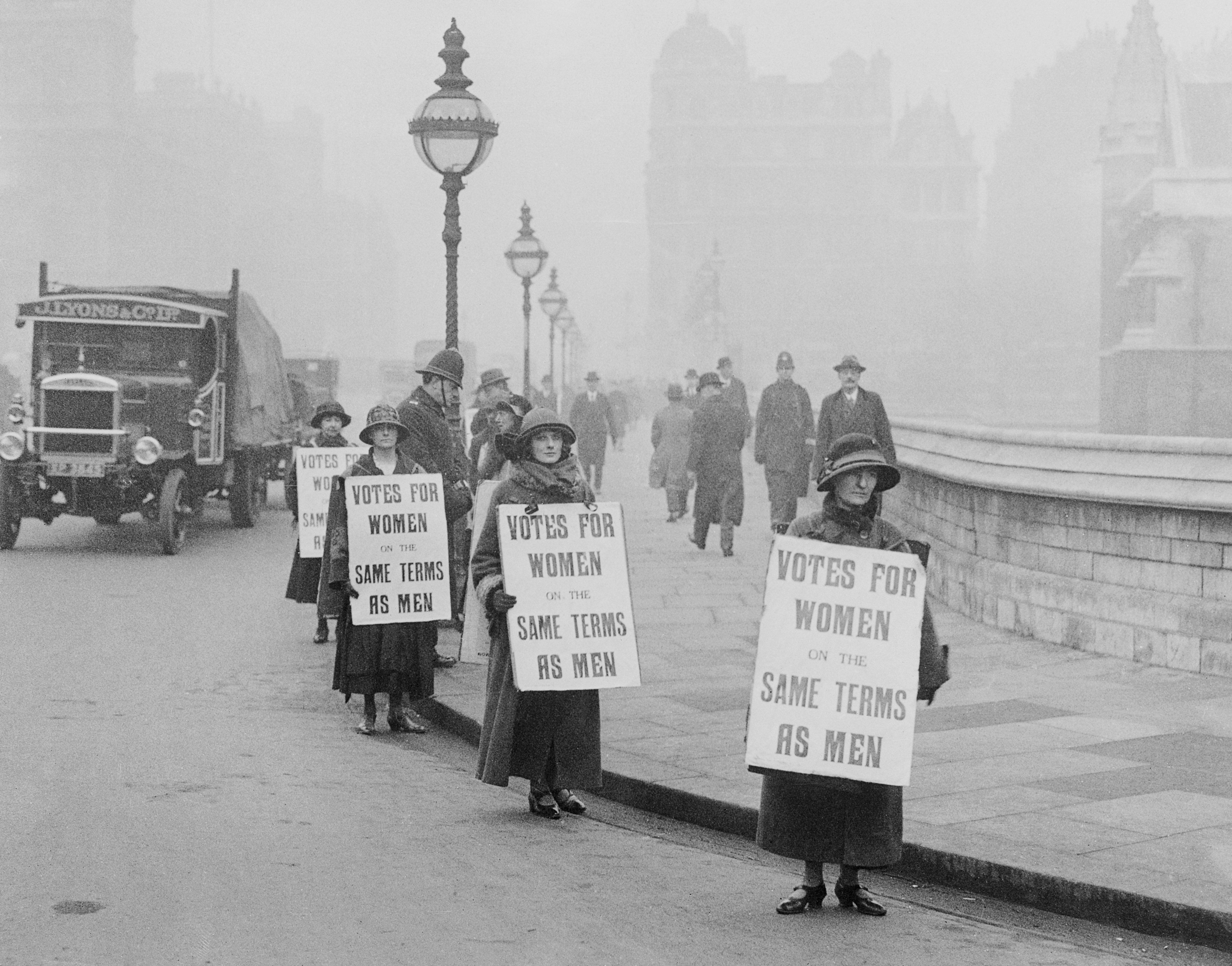A group of suffragists picket outside the House of Commons in the early 1900s/