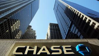 NEW YORK, NY - OCTOBER 14:  A sign hangs on One Chase Plaza in lower Manhattan on October 14, 2014 in New York City. JPMorgan Chase, the nation's largest bank, reported third-quarter net income of $5.6 billion, or $1.36 per share, returning the bank to third quarter profitability.  (Photo by Spencer Platt/Getty Images)