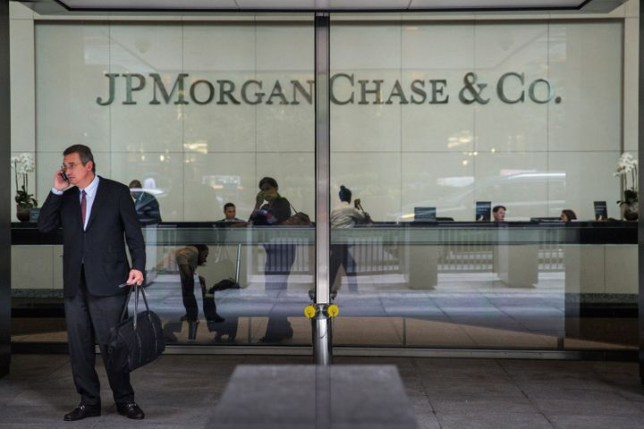 A man stands outside JP Morgan Chase's corporate headquarters on August 12, 2014 in New York City. U.S. banks announced secon