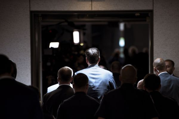 Former FBI Director James Comey walks to a closed-door hearing before the Senate Select Committee on Intelligence on June 8,