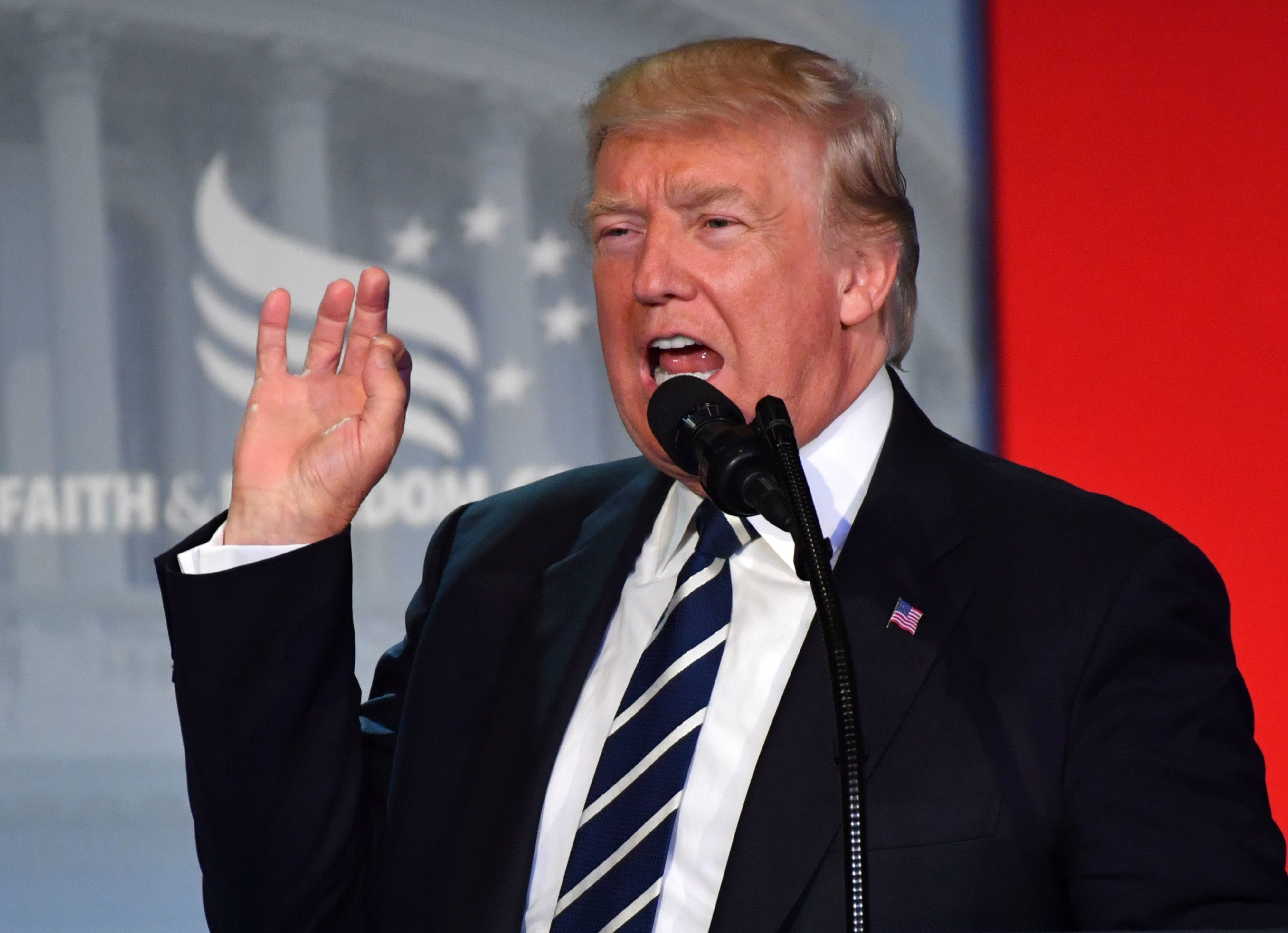 US President Donald Trump addresses supporters at a Faith and Freedom Coalition event in Washington DC on June 08, 2017. President Donald Trump avoided directly responding to explosive accusations made by his ex-FBI director Thursday, but sought to rally supporters behind a message of defiance. 'We are going to fight and win' Trump said, addressing supporters at a Faith and Freedom Coalition event in the capital.  / AFP PHOTO / Nicholas Kamm        (Photo credit should read NICHOLAS KAMM/AFP/Getty Images)