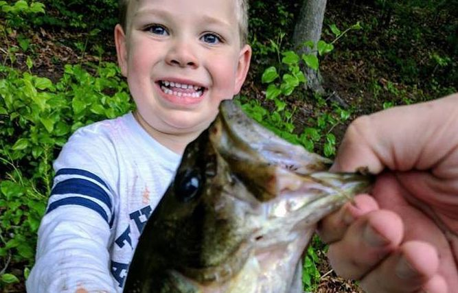 <p>Sam, 3, with a fish that's not the first one he ever caught himself</p>