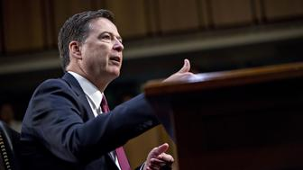 James Comey, former director of the Federal Bureau of Investigation (FBI), speaks during a Senate Intelligence Committee hearing in Washington, D.C., U.S., on Thursday, June 8, 2017. Comey in prepared remarks to the committee said U.S. President Donald Trump sought his loyalty and urged him to drop the investigation into former National Security Advisor Michael Flynn. Photographer: Andrew Harrer/Bloomberg via Getty Images