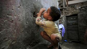 "Five-year-old Karkar tries to drink water from a faucet near his home in the Eshash el-Sudan slum in the Dokki neighbourhood of Giza, south of Cairo, Egypt September 2, 2015. Residents of the slum clashed with police in late August, when about 50 ramshackle huts were destroyed and at least 20 people were injured by teargas, local media reported, as authorities attempt to clear the area and rehouse residents. The slum dwellers, some of whom have called Eshash el-Sudan home for 50 years, say there are not enough apartments built nearby to house them. The residents of the slum eke out a living by disposing of rubbish or baking bread. Schooling is too expensive for most of their children, who play with salvaged rubbish amid shacks made out of discarded wood and leather. REUTERS/Amr Abdallah DalshSEARCH ""ESHASH EL-SUDAN"" FOR ALL PICTURES       TPX IMAGES OF THE DAY"