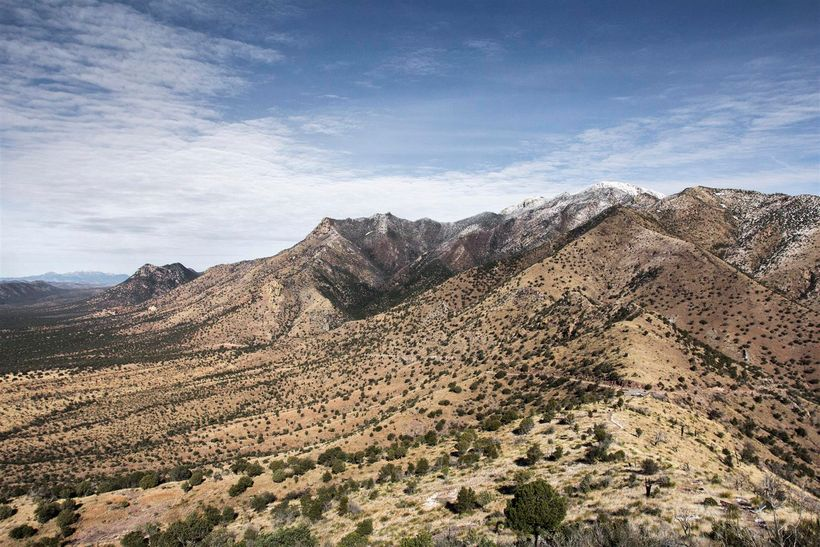 A view from Montezuma Pass of late season snow on the Huachuca Mountains.
