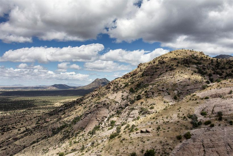 The trail winds down below the pass offering huge views of the surrounding desert.