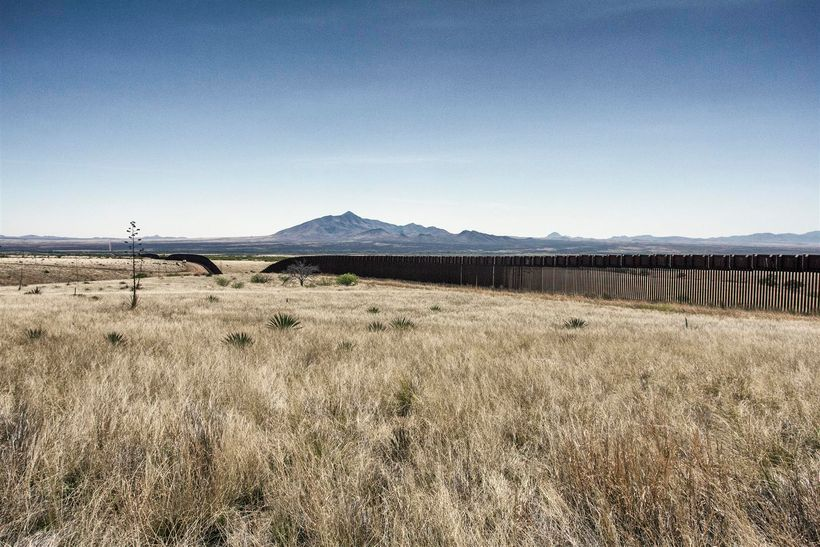 Border Patrol agents driving patrol on the fence line at edge of the Coronado National Memorial.