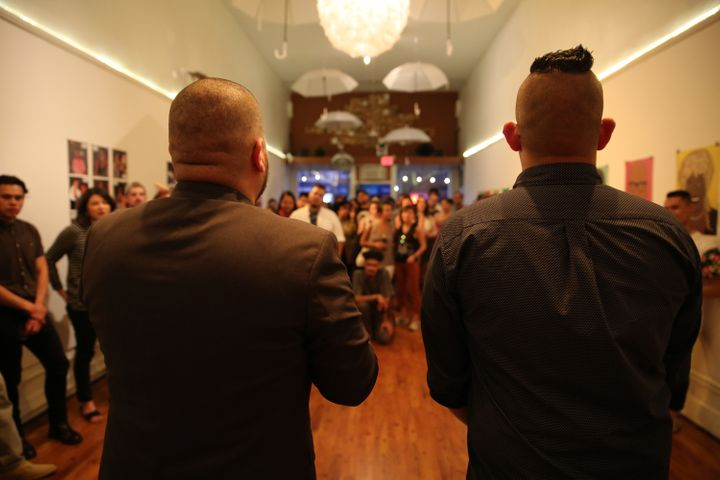 <em>Artists Julio Salgado and Chucha Marquez addressing show attendees during the May 20 opening of Que Siga La Fiesta in Oak